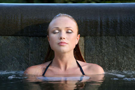 Portrait of beautiful woman in water photo