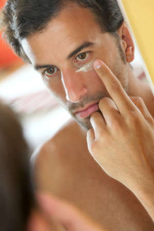 Man taking care of his skin photo