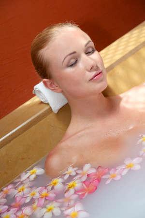 Portrait of beautiful woman in milk bath photo