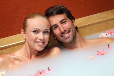 woman bath: Couple relaxing in spa milk bath