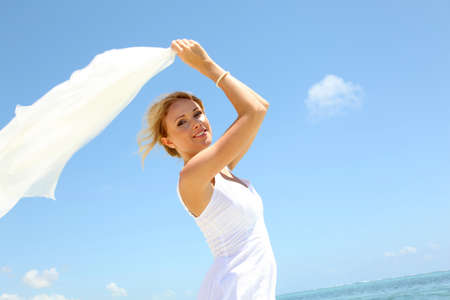 Bride on the beach with white stole photo