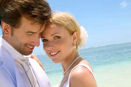 wedding beach: Portrait of just married couple on the beach