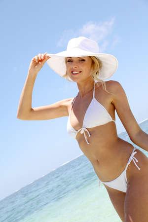 blonde bikini: Beautiful blond woman in bikini by blue lagoon Stock Photo