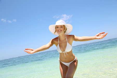 indian sexy: Beautiful blond woman in bikini by blue lagoon Stock Photo