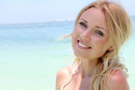 Beautiful blond woman in ocean water photo