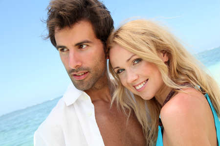 Portrait of in loved couple on beach holidays photo