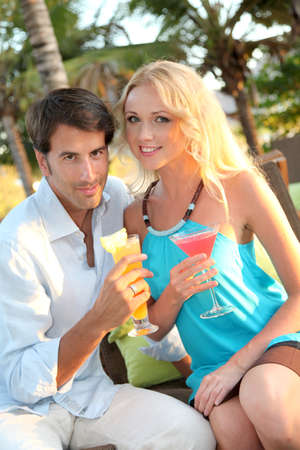 Just married couple having a cocktail in luxury resort photo