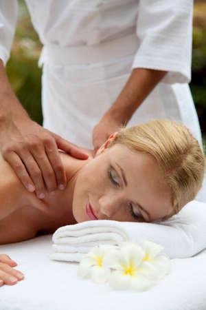 Beautiful woman having a massage on her back Stock Photo - 11503087