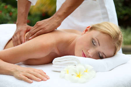 Beautiful woman having a massage on her back photo