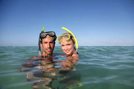 snorkeling: Couple with snorkeling equipment Stock Photo