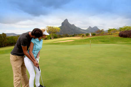 Couple playing golf Stock Photo - 11517714