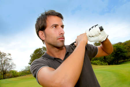 Portrait of man holding golf club photo