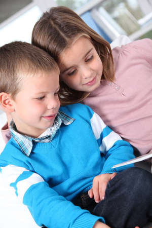 Children reading book at home Stock Photo - 11517690