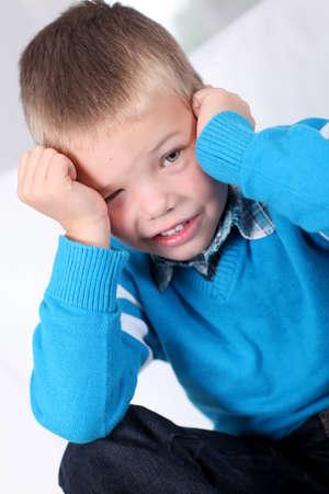 blond boy: Portrait of shy little boy Stock Photo