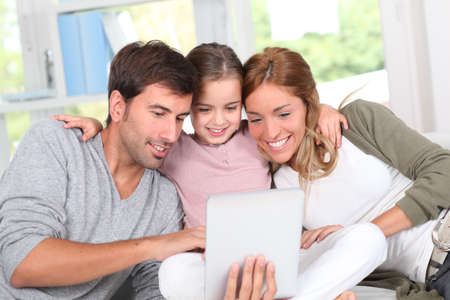 internet love: Family using electronic tablet at home