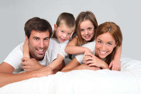 Family portrait laying in bed photo