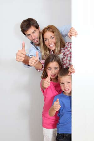 promotion girl: Happy family standing by whiteboard