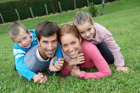 Portrait of happy family lying down in grass Stock Photo - 11517668