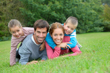 Portrait of happy family lying down in grass Stock Photo - 11517735