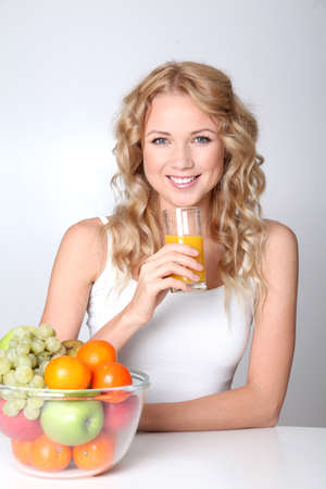 Beautiful blond woman drinking fruit juice Stock Photo - 11518121