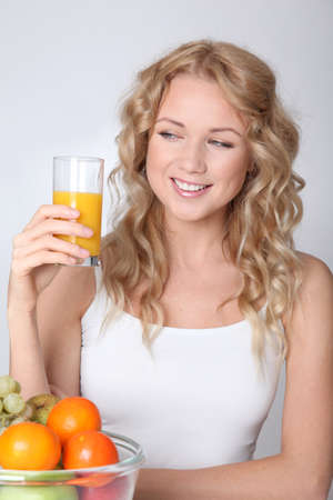 Beautiful blond woman drinking fruit juice Stock Photo - 11518125