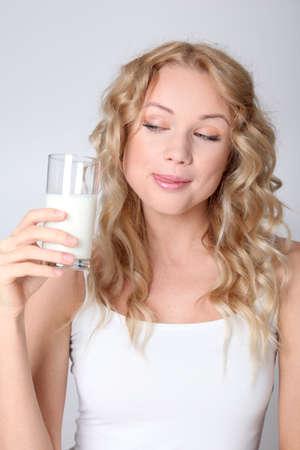 Blond woman drinking fresh milk photo
