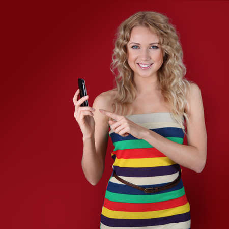 Beautiful woman pointing at mobilephone Stock Photo - 11518509