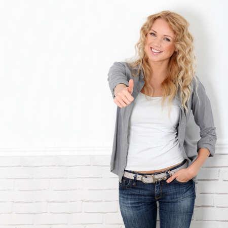 whiteness: Beautiful blond woman showing thumb up