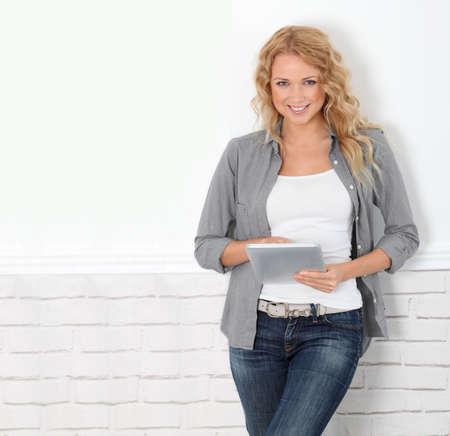Beautiful modern woman using digital tablet photo