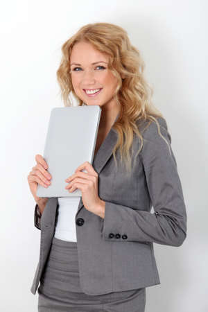 Businesswoman standing on white background with touchpad Stock Photo - 11517878