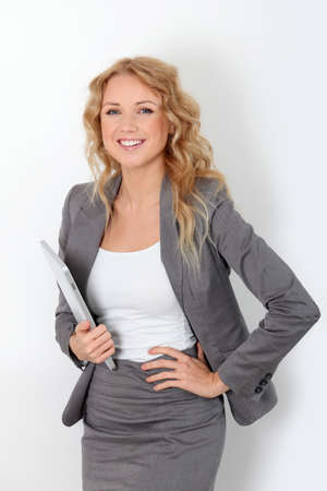 saleswoman: Businesswoman standing on white background with touchpad Stock Photo