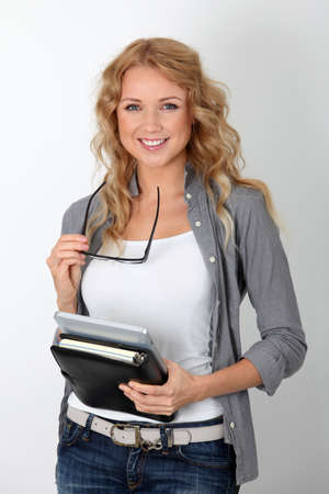 Cheerful office worker with electronic tablet and agenda photo