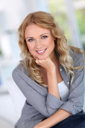 Portrait of beautiful blond woman relaxing at home photo