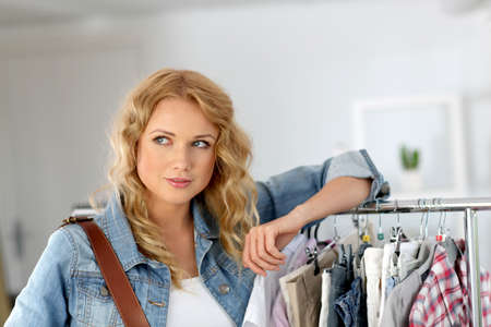 togs: Woman standing in garment store