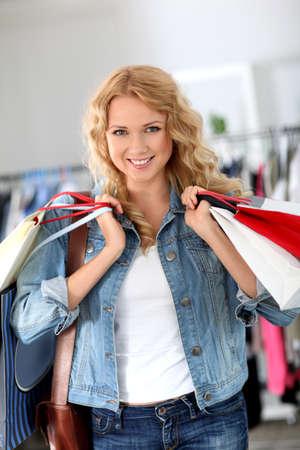 bargain: Smiling woman holding shopping bags