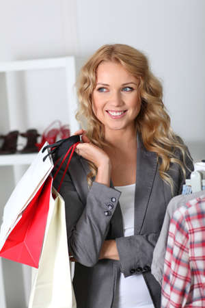 Cheerful woman holding shopping bags photo