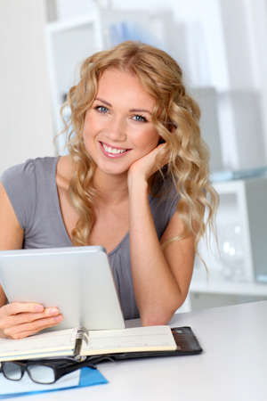 Beautiful woman in office using digital tablet Stock Photo - 11614964
