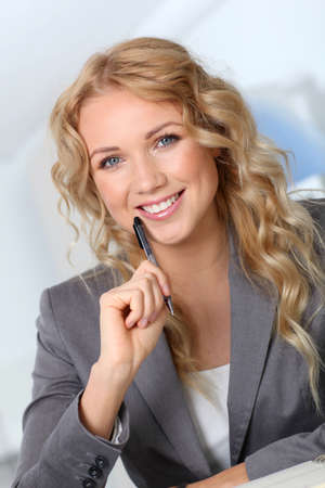 Portrait of beautiful blond businesswoman in office photo