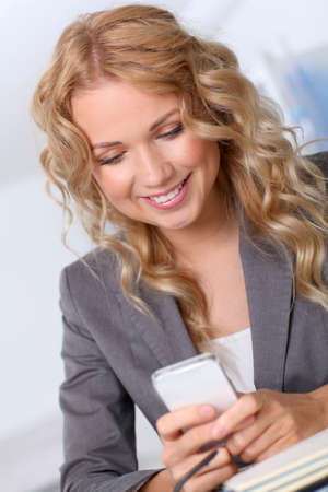Portrait of businesswoman using mobile phone Stock Photo - 11614790