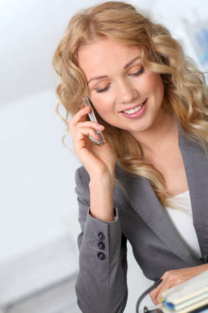 phonecall: Portrait of businesswoman using mobile phone