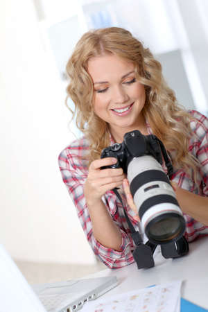 Photographer looking at photo camera Stock Photo - 11614969
