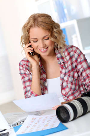 Beautiful photographer looking at story board for photo session Stock Photo - 11614945