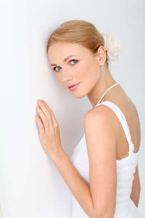 Portrait of beautiful bride on white background photo