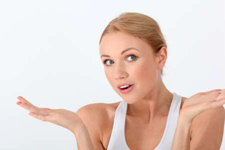 questioning: Portrait of beautiful blond woman with interrogative look