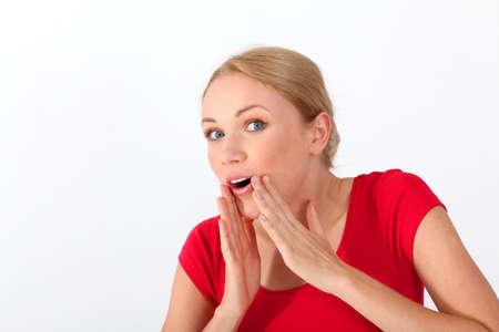 telling: Portrait of blond woman whispering