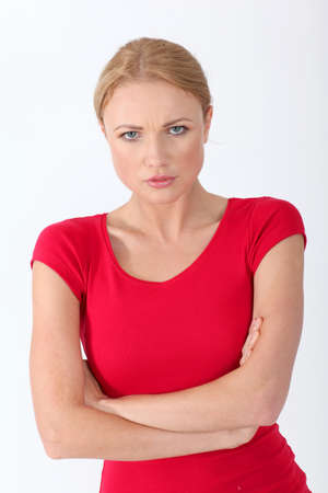 woman serious: Woman in red shirt with sad look on her face