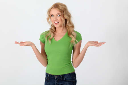 Beautiful woman wearing green shirt with surprised look photo