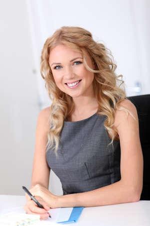 saleswoman: Portrait of beautiful woman in office Stock Photo