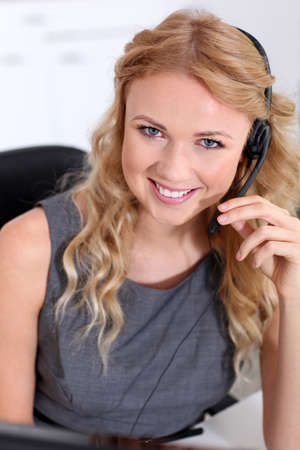 Beautiful customer-service woman with headset on photo