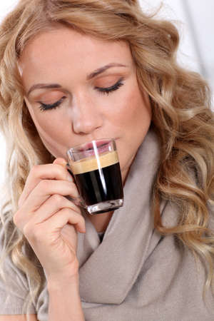 expresso: Portrait of blond woman drinking expresso Stock Photo